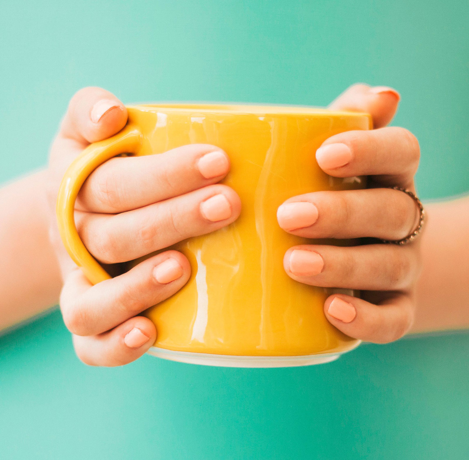 Man Holding a Cup | The Definitive Rules For Putting Milk In Tea